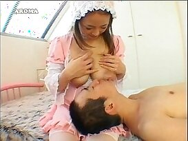 Pretty Japanese has her milky breasts sucked