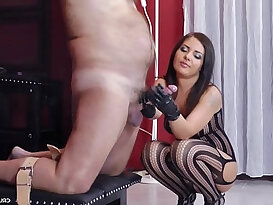 Dominant bitch Lisa jerking off guys in her tormentroom